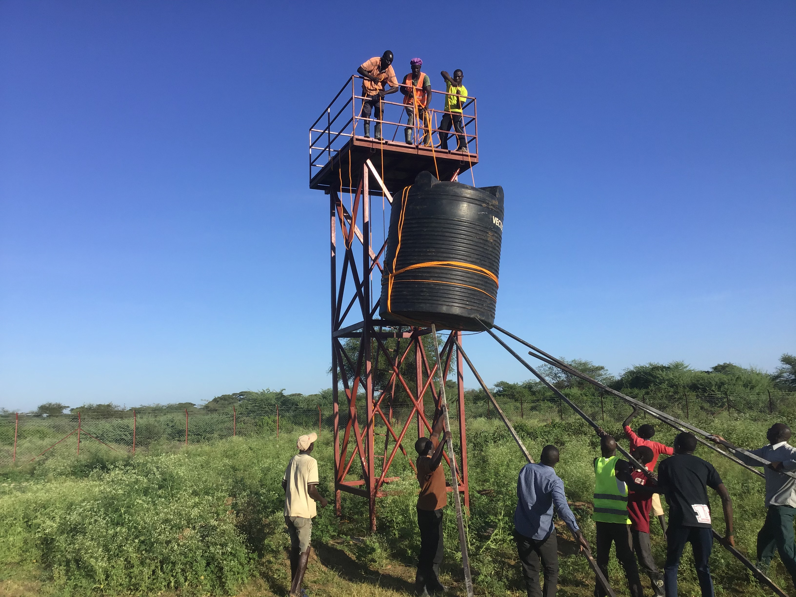 Construction of the water tower by the local people of Riwota